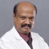 Dr. Jacob K.S.